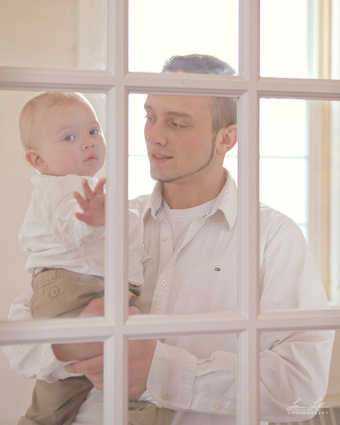 Great-grandson checks out what is happening through the window
