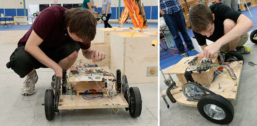 putting the finishing touches on the robots